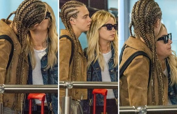 Cara Delevingne confirms she's dating Pretty Little Liars star Ashley Benson as they share a passionate kiss at Heathrow Airport