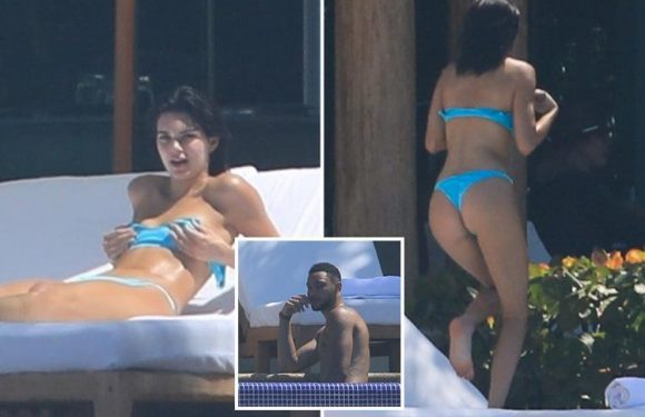 Kendall Jenner sunbathes in a blue thong bikini as she holidays with boyfriend Ben Simmons