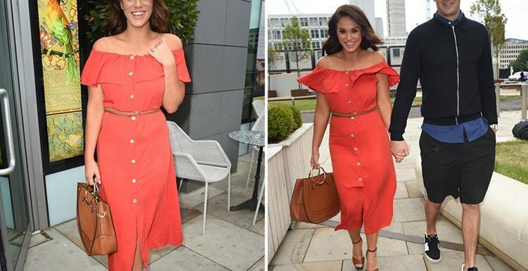 Vicky Pattison wows in red as she's reunited with fiance John Noble after filming 'secret TV project'