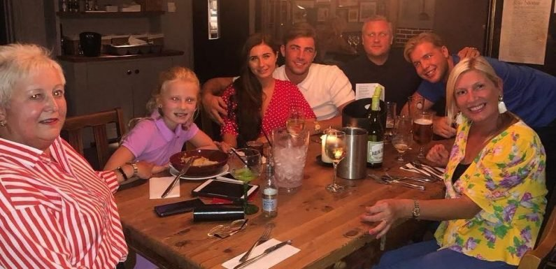 Love Island's Dani Dyer cuddles up to Jack Fincham as they have dinner with his family
