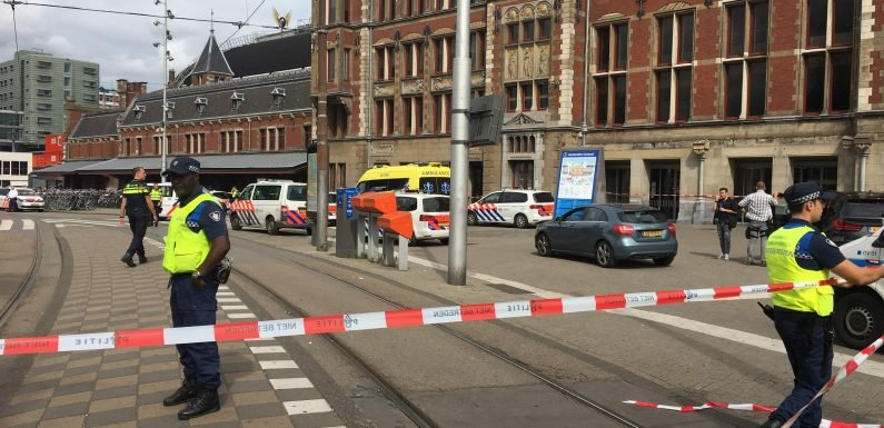 Amsterdam 'stabbing in Central train station sparks panic as cops shoot suspect'