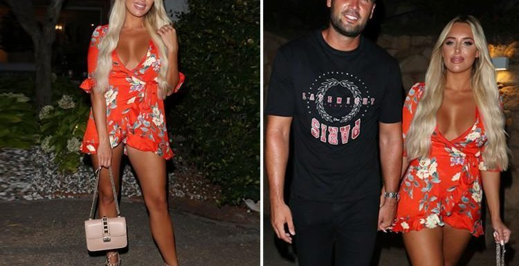 Amber Turner flashes her legs in a plunging playsuit in Sardinia with boyfriend Dan Edgar and the Towie cast as they film new series