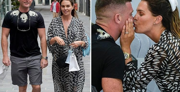 Danielle Lloyd smooches fiancé Michael O'Neill as they try on wedding rings together