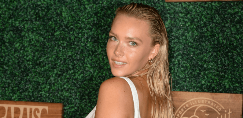 Camille Kostek Shows Off Curves In Blue Mini Dress And Thigh-High Boots On Instagram