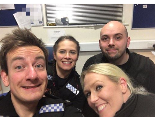 Pranksters are using this old grinning cops selfie to trick their mates into visiting police stations in latest viral craze