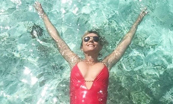 Elizabeth Hurley's Cleavage Spills Out Of Her Red Hot Swimsuit In Sexy New Pic