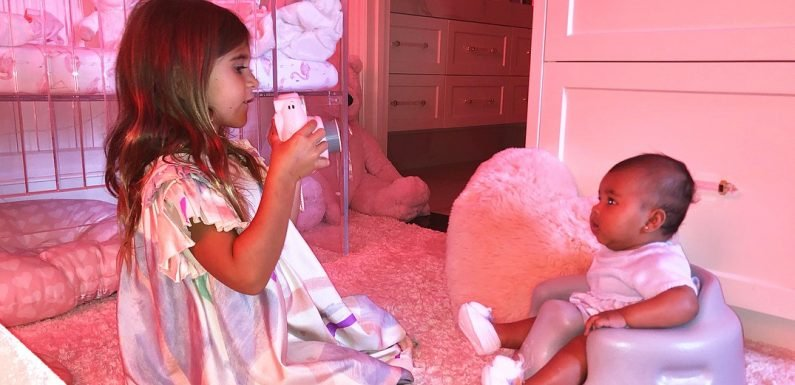Penelope Disick Plays Photographer With Baby True Thompson