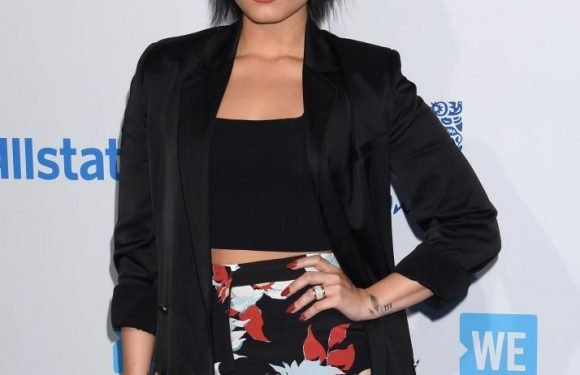 Demi Lovato 'still in hospital with nausea and high fever after drug overdose'