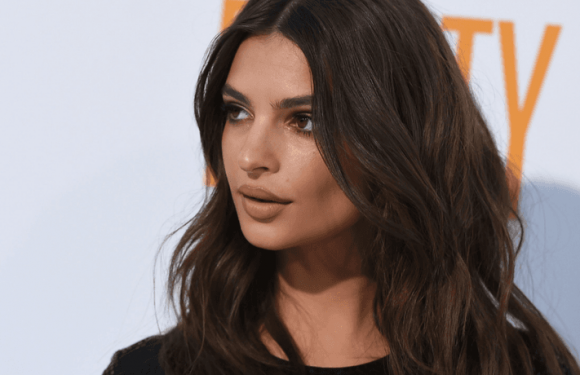 Emily Ratajkowski Looks Coy In A Plunge Swimsuit