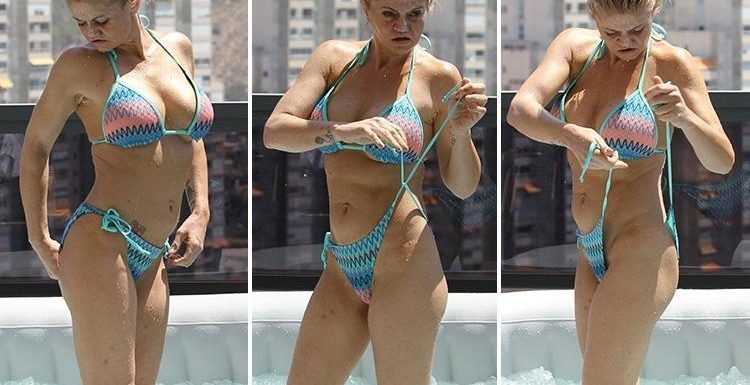 Danniella Westbrook has a dip in a paddling pool with suntan lotion smeared all over her face