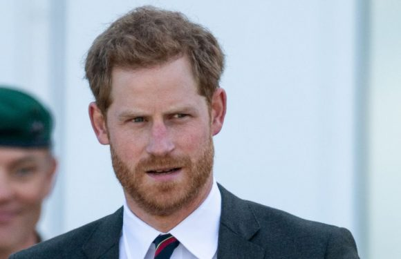 Prince Harry fiddles with wedding ring on solo jaunt and expert explains why