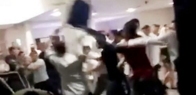 Shock mass brawl at boxing event with as chairs fly and punches thrown