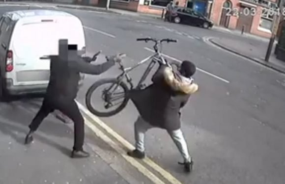 Cyclist throws bike at knifeman who chased him down street in broad daylight