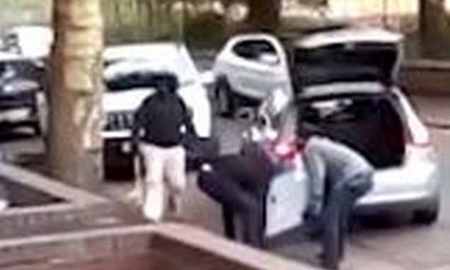 Watch three robbers bundle a safe into their Audi before speeding off