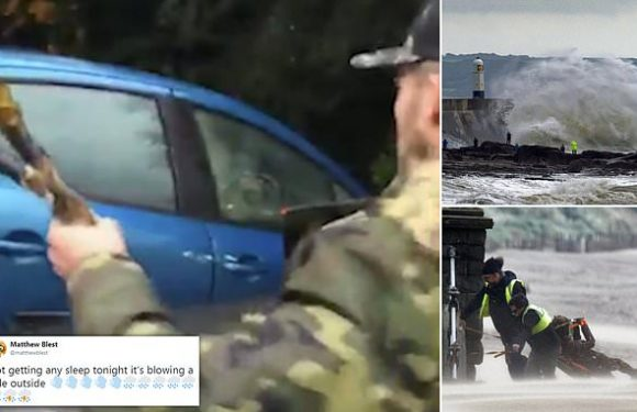 Hero drags elderly woman from flooded car in Britain