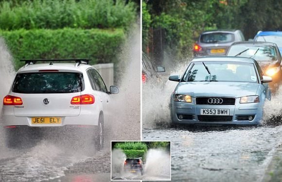 London drivers struggle through flash floods on first day of autumn