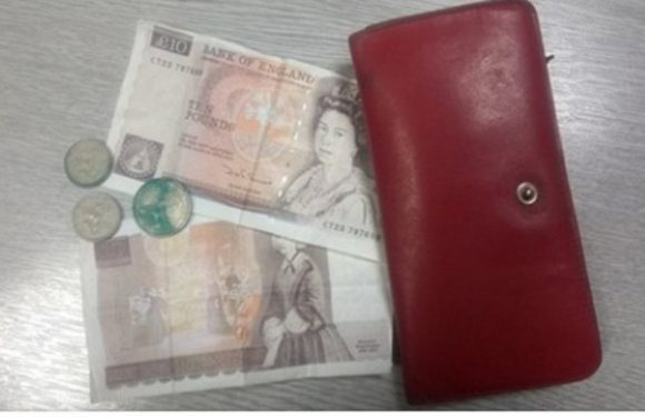Police reunite owner of purse 31 YEARS after it went missing