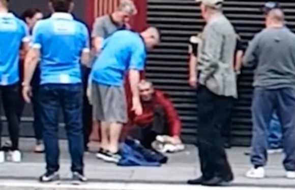 Shocking moment football fan kicks a homeless man in the face
