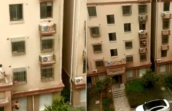 Heroic men scale four storeys with BARE HANDS to save trapped girl