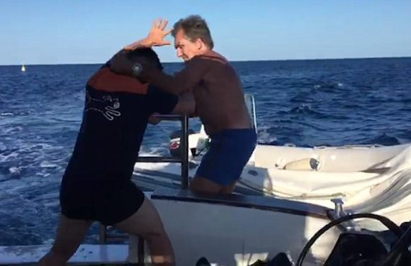 Angry sailor yells 'I'll kill you one by one' while chasing a boat