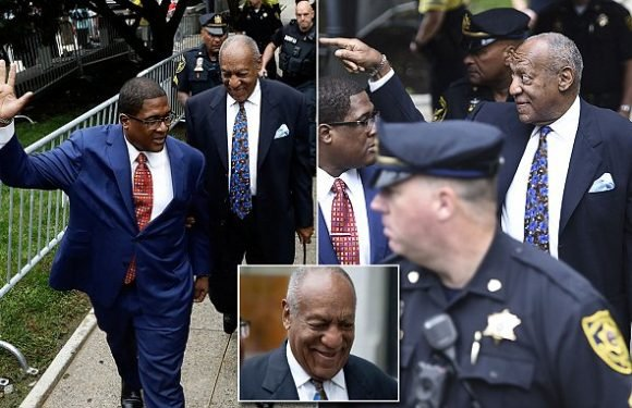 Bill Cosby arrives alone in court and smiles at protesters