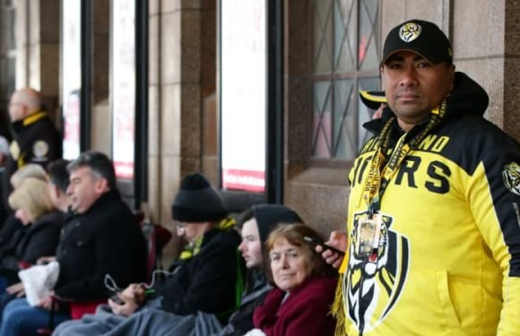 'Yellow and black, back to back': Footy fans secure finals tickets after days of camping out