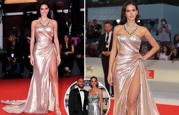 Neymar's girlfriend Bruna Marquezine stuns in a strapless gold dress on the red carpet at Venice film festival