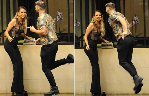 Jake Quickenden leaps into the air while teaching Olivia Attwood how to dance as they get close at TV Choice Awards