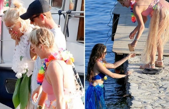 Pixie Lott drops her phone in the sea and makes her friend jump in and rescue it during hen party in Greece