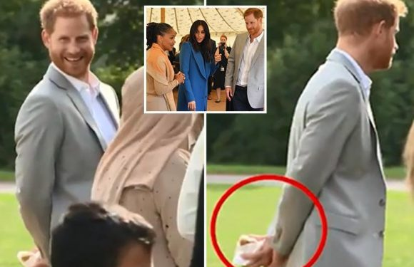 Cheeky Prince Harry caught red-handed 'stealing' samosas at Meghan Markle's Grenfell cookbook launch