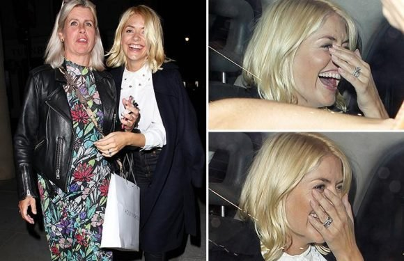 Holly Willoughby gets the giggles as she heads home after boozy night out with her sister in London