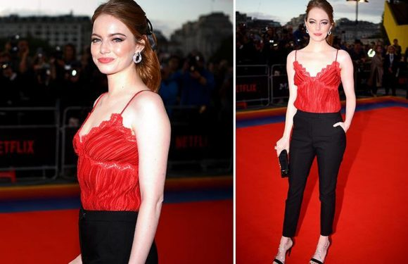 Emma Stone braves the cold weather in a red lacy camisole as she joins Justin Theroux at Netflix's Maniac premiere in London