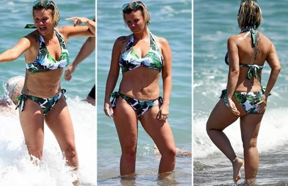 Kerry Katona shows off her curves in a tropical print bikini during holiday in Spain