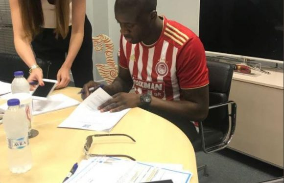 Olympiakos fans light flares as Yaya Toure arrives in Athens to sign for Greek giants