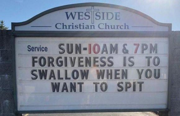 Priest claims sign telling believers to 'swallow when they want to spit' is totally innocent… but is everything as it seems?