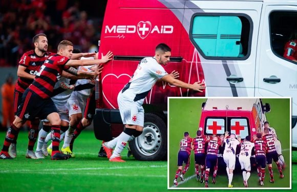 Flamengo and Vasco da Gama players have to push ambulance off pitch after it breaks down