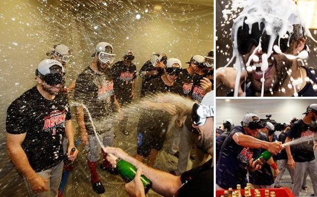Boston Red Sox wear goggles as they soak clubhouse in champagne while celebrating American East league title win over New York Yankees