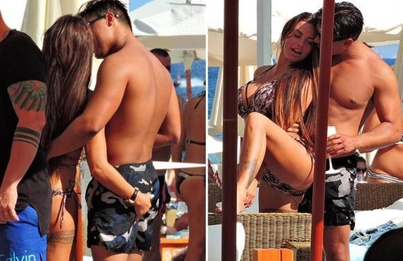 Katie Price snogs and gropes new toyboy boyfriend Alex Adderson in Majorca 24 hours after split from Kris Boyson