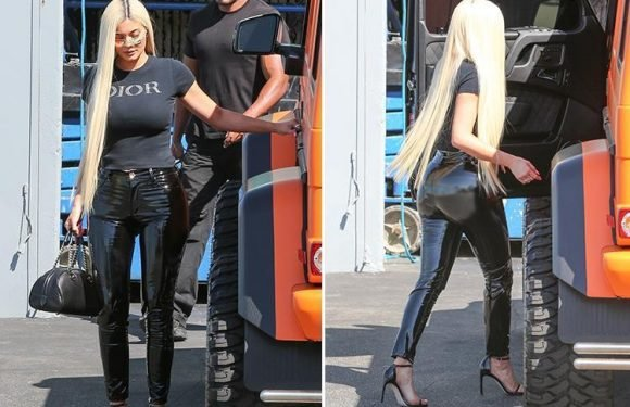 Kylie Jenner looks incredible in skintight latex trousers and long blonde wig
