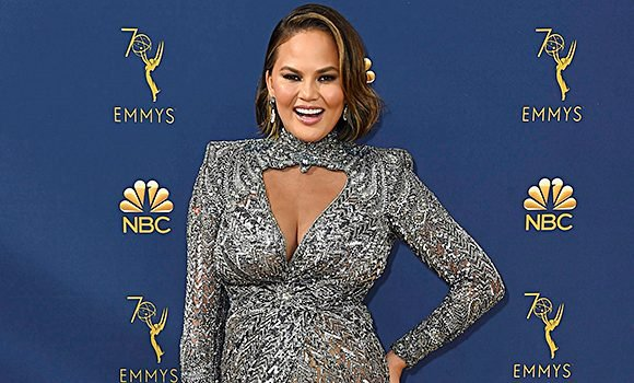 Chrissy Teigen Sparkles In Silver While Supporting John Legend At Emmy Awards