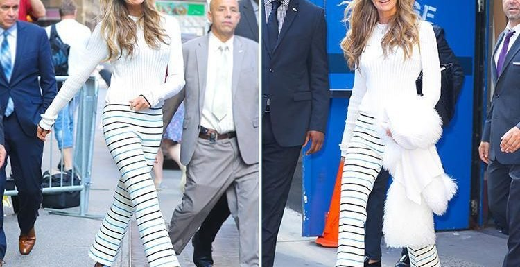Elle Macpherson wows in eye-catching striped trousers while out in New York City
