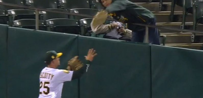 A's fan helps ruin game and save the Yankees