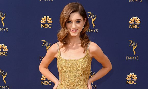 Natalia Dyer Shines Bright In A Glittering Gold Gown At The 2018 Emmy Awards