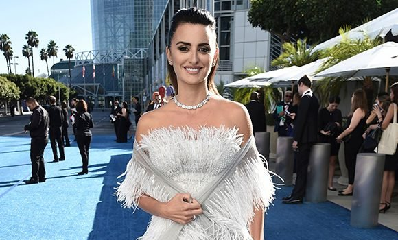 Penelope Cruz Stuns In A Strapless White Feathered Dress At Emmys