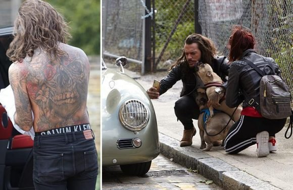 Pete Wicks goes topless as he shoots new calendar with pet dogs Eric and Peggy