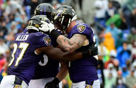 Ravens win wild one over Broncos as rookie RB Lindsay ejected