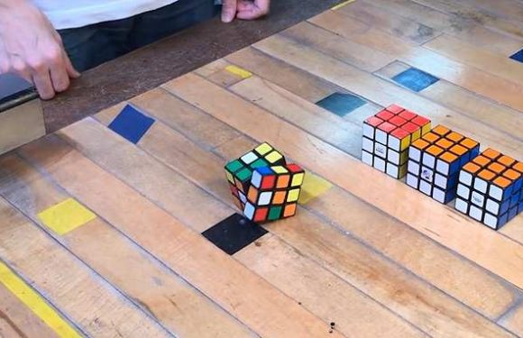Classic Rubik's cube with robotic core completes itself in 30 seconds