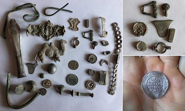 Silver coins that are thought to be 1,000 years old are unearthed