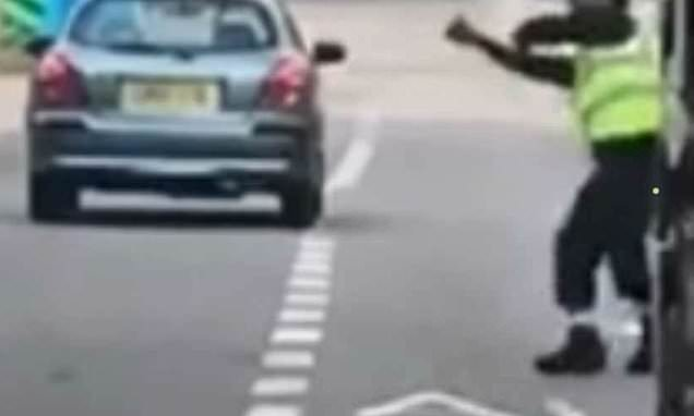 Two furious drivers hurl a BRICK at each other's vehicles