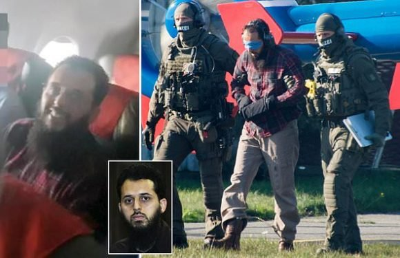 9/11 terror attack accomplice pictured grinning on deportation flight